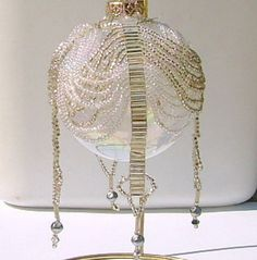 I made something very similar to this under the expert guidance of Karen Torrisi - not as difficult as it looks but takes lots of time. Beaded Christmas Ornaments, Ball Ornaments, Christmas Tree Decorations, Handmade Christmas, Christmas Crafts, Beaded Crafts, Jewelry Crafts, Beaded Jewelry, Beaded Rings