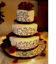 http://fashion881.blogspot.com - I love the elegant look of black and white wedding cakes. This one is black icing scrolls crawling up a white fondant cake with fresh red roses for accents.