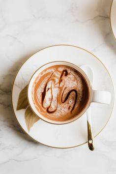 A rich and creamy vegan superfood hot chocolate recipe touched with a pinch of fragrant cardamom and nutty tahini.
