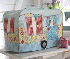 """A dust cover is important to help keep your machine clean, why not make it pretty as well as practical.  Pattern makes a cover size 19"""" across, 9"""" deep and 13"""" tall. Size can be increased  Includes: A1 pattern sheet and step by step pictorial instruction booklet"""