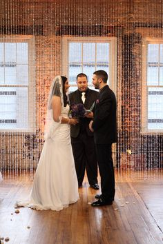 Brick light covers hide the fixtures on the floor! Get Lit, perimeter up-wash in amber and an elegant crystal curtain as a ceremony backdrop in The Stockroom. Photo: J Darren Photography