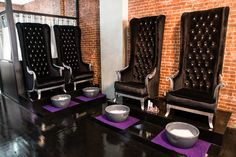 Tall wing back tufted chairs with silver painted wood...Great for pedicures. Cool Salons: Bed of Nails | Salon Fanatic
