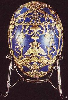 "Year delivered 1912 Customer Alexandra Fedorovna Current owner Year of acquisition 1947 Design and materials Workmaster Henrik Wigström Materials used Lapis Lazuli, gold, diamond Height 5¾"" Width 4"" Surprise Russian double-headed Imperial eagle with portrait of the Czarevich Alexis"