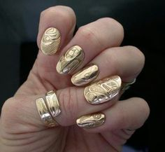 Gold nails, the etching has a Northwest coastal design to it.