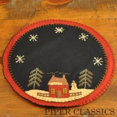 """Winter Candle Mat - Large; 14"""" in diameter.  Hand appliqued and embroidered with lots of detail, these candle mats are designed as a decorative trivet for your candle pans or jar candles, protecting your surfaces as well as providing an attractive accent. The large mats also work great under lamps or centerpieces. #christmas theme placemat #winter candle mat"""
