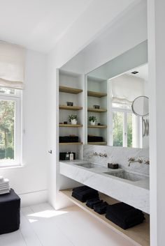 Floating marble sink. Can also be done with Fiora + Artelinea. Side storage great, but tidiness an issue in open storage. Could be better with pullout.