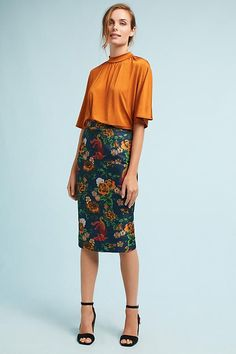 I love EVERYTHING about this outfit from the print pencil skirt to the flowy vibrant top to the very simple heel.