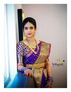 Purple kanjeevaram saree with brocade blouse. Temple jewellery belt