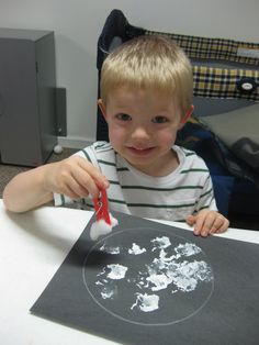 Moon Painting. With a white crayon, trace cereal bowl on black construction paper.  Put a cotton ball or sponge in clothespin.  Dip in white paint and dab.