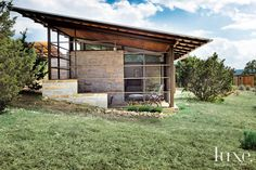 Exposed steel and limestone are right at home amid the area's rugged natural beauty. The skillion roof has overhangs that provide shading from the bright Texas sun. See more at www.luxesource.com.