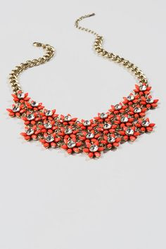 "Brighten up your outfit with the Morgan Statement Necklace!  Tiny coral flowers, accented with shiny clear crystals, create a floral bib that will cheer up any gloomy Fall day.  Pair this with a chunky sweater and boots for a great day time look.<br /> <br /> - Finished with a lobster claw clasp<br /> - 16.5"" length<br /> - 3"" extension<br /> - Lead & nickel free<br /> - Imported"