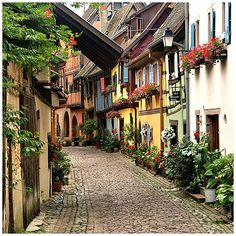 Cobblestone Street, Eguisheim, France. Go to www.YourTravelVideos.com or just click on photo for home videos and much more on sites like this.