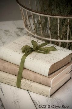 Romantic book covers. Good idea for decorating with books that may have unattractive covers.