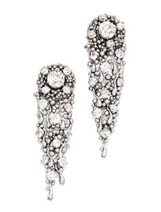 PAIR OF WHITE GOLD AND DIAMOND PENDANT-EARRINGS, CHARLES DE TEMPLE. Of flexible design, topped by two old mine-cut diamonds weighing 1.84 and 1.68 carats, accented by 26 smaller old mine-cut diamonds weighing approximately 2.50 carats, signed CDET; pendants and wreath-form jackets removable.