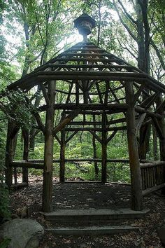 A rustic arbor made from fallen trees in the woods. Id want mine to be more simple, but the idea is cool. Garage Pergola, Pergola Garden, Diy Pergola, Pergola Plans, Pergola Ideas, Backyard Ideas, Corner Pergola, Pergola Kits, Patio Ideas