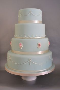 Rose cameo and pearls wedding cake by madebymariegreen, via Flickr