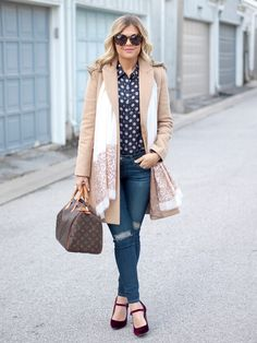 Loving this fall outfit from Suburban Faux Pas. She styles our navy printed ruffle top with distressed denim and red velvet pumps. She tops off the look with a camel coat and sequin scarf | Banana Republic