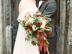 Cascading fall bouquet. Bridal bouquet with burnt orange, burgundy, and white flowers. Fall wedding color ideas for NJ wedding.