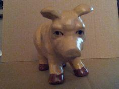 Not so cute old ceramic piggy bank.