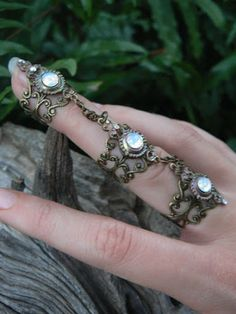 slave ring triple armor ring claw ring wite opal glass nail ring goth victorian steampunk moon goddess pagan witch boho gypsy style by gildedingypsy on Etsy Viktorianischer Steampunk, Steampunk Fashion, Steampunk Rings, Gothic Rings, Steampunk Wedding, Gothic Wedding, Steampunk Clothing, Gypsy Style, Boho Gypsy
