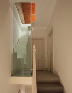 staircase replecing a standard skinny ladder. It's only a folded sheet of steel connected to a newly-renovated living room area in a small London flat