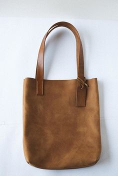 Leather tote, holds your laptop and books... or use as a large purse. Handstitched by Peartree Leather Co.