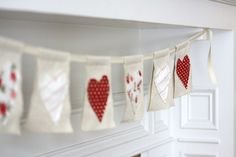 burlap drop cloth from lowes, cheap fabric hearts = quick cute banner for any occasion.