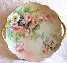 Beautiful cake plate with hand-painted roses.
