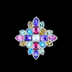 Chanel White gold brooch with diamonds, green and yellow beryls, amethysts, tourmalines, aquamarines and pearl. San Marco collection