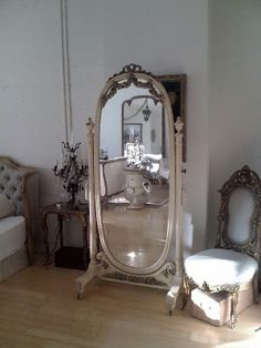 standing oval mirror....gorgeous! I have a plain one is storage that I could add wooded details to and paint. Yay! Another project. :)