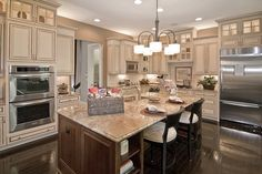 Dream Kitchen; Almond/Cream Kitchen Cabinets with Chocolate Pin Glaze; Dark Contrasting Island; Dark wood floors