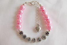 Girls pink pearl and silver plated letter bead bracelet with extension chain and heart charm.     £5 (inc P)