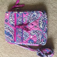 Purple and Navy Paisley Patterned Small Hipster Gently used, gorgeous pattern! In the last picture you can see there is wear on the shoulder strap and on the upper part of the back pocket. The inside looks brand new, and there are no stains anywhere on this purse. Willing to negotiate, so feel free to make an offer Vera Bradley Bags