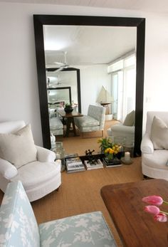 Living room. Love the mirror idea!