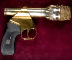 Prince's famous gold microphone gun.