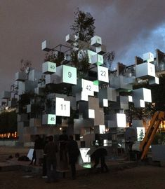 Commissioned by Parisian art gallery Philippe Gravier, japanese architect Sou Fujimoto has created an installation in Paris' Jardins des Tuileries composed of suspended metal cubes and plants, for the FIAC art fair.
