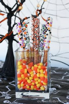 Chocolate Dipped Pretzel Rods Halloween Style! The recipe is here http://www.ourbestbites.com/2008/12/dipped-pretzel-rods/