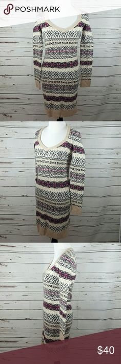 MODA International Sweater Dress MODA International sweater dress.  Size Small.  44% Acrylic/27%Nylon/22%Wool/4%Alpaca/3%Elastane.  Fairisle design, with hues of cream, tan, charcoal gray, and magenta.  Pairs perfectly with leggings and booties or simply as a dress. Chest measures approximately 16 inches from armpit to armpit. Length from shoulder to hem is approximately 34 inches.  Excellent pre-owned condition. Moda International Dresses