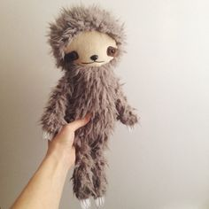 Sloths are so cool. Who wouldnt want a laid back friend whos always smiling? Now you can have your own in bijoukitty plush style.  This sloth is