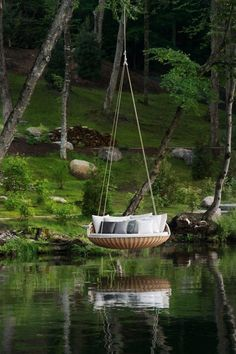 Not a pool but water related. A cool swing that would be cool to sleep in