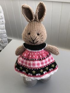 This little bunny is all dressed up for a tea party!! Her dress started with a long tail cast on of 96 stitches and 16 repeats of the pattern shown on the left. The dress was knit with a fuller ski...