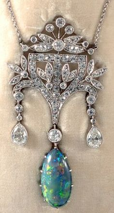 Stunning platinum set fine quality Edwardian diamond and black opal boxed pendant 1910c