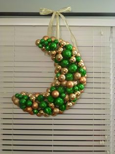 Crescent made from foam form and hot glued decoration balls.  Seems easy