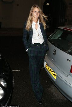 Cara Delevingne in Vivienne Westwood's Black/Green tartan jacket and trousers, with a Popeline blouse.