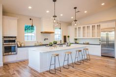 love the island, pendant lights, leathered granite countertops - add some gold hardware