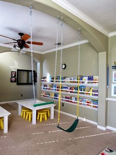 Basement playroom ideas that inspire imaginative play for toddlers, pre-schools, and elementary age kids! Kids Indoor Play, Indoor Gym, Indoor Swing, Indoor Playground, Hangout Room, Gym Room, Basement Inspiration, Kids Swing, Home Daycare