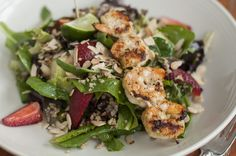 Grilled Chile-Lime Prawn Salad. Spring greens, Mexican cinnamon toasted quinoa, strawberries, honeydew, toasted almonds, spiced lime vinaigrette.