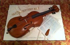 Cello birthday cake made for a cello playing conductor - everything is edible.