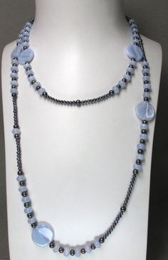 Blue Lace Agate and black fresh water pearls necklace. $200.00, via Etsy.