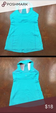 Lululemon scoop neck athletic top Kelly green scoop neck athletic top. It was a favorite of mine but still in great condition. This style was as classic! Has a built in shelf bra but no cups lululemon athletica Tops Tank Tops